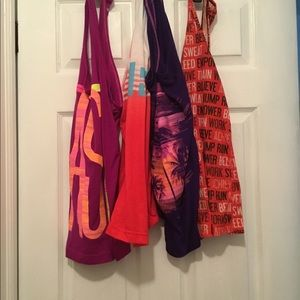 Lot of 4 workout tops, Lg/Med Great deal!